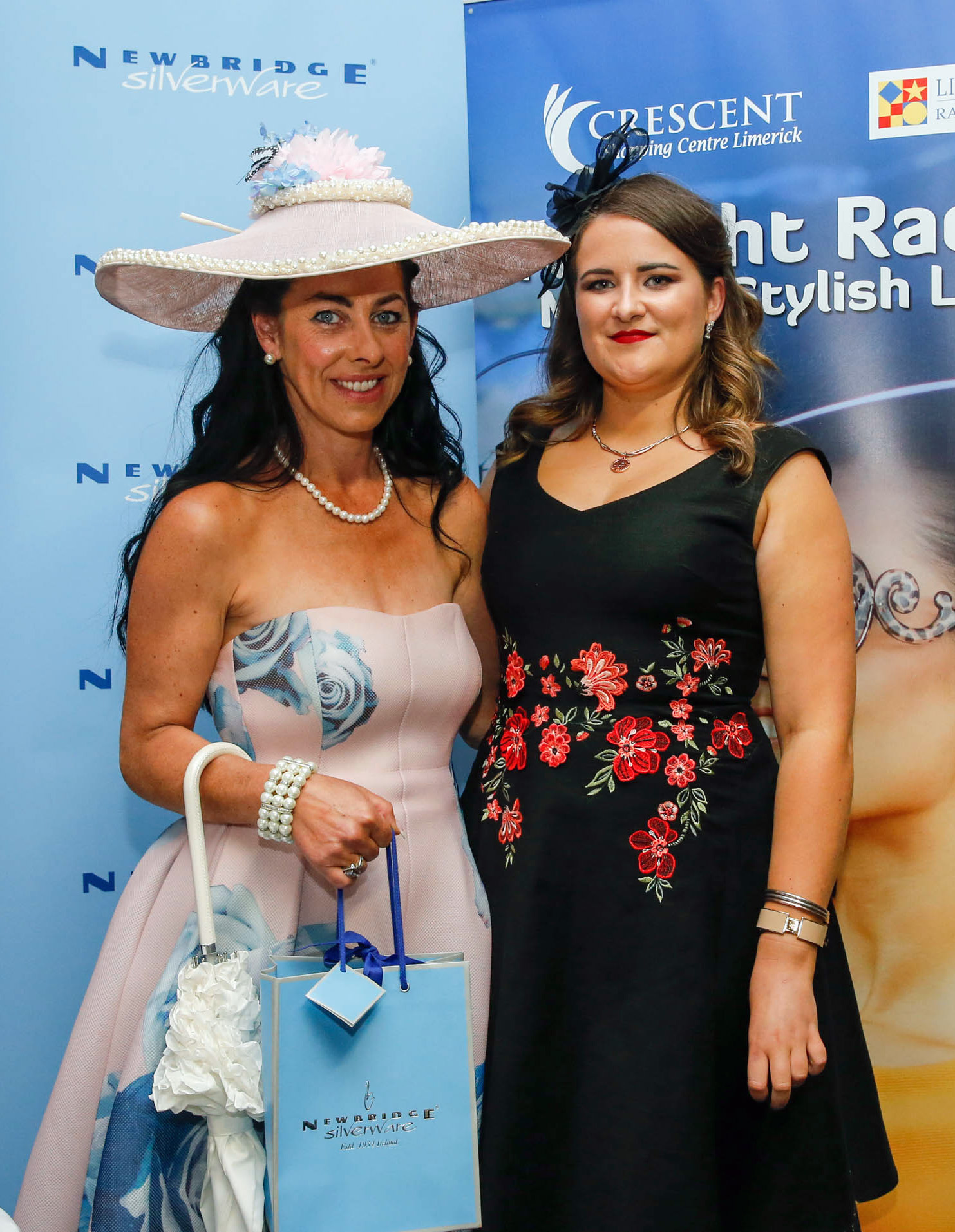 11-6-16 coral.ie Race Day at Limerick Racecourse.Most stylish competition' sponsored by Newbridge Silverware & Neville Jewellers, The Crescent Shopping Centre.Winner was Grace Flynn from Kilcornan pictured here with Roisin Madden, Newbridge Silverware.Picture: Keith Wiseman