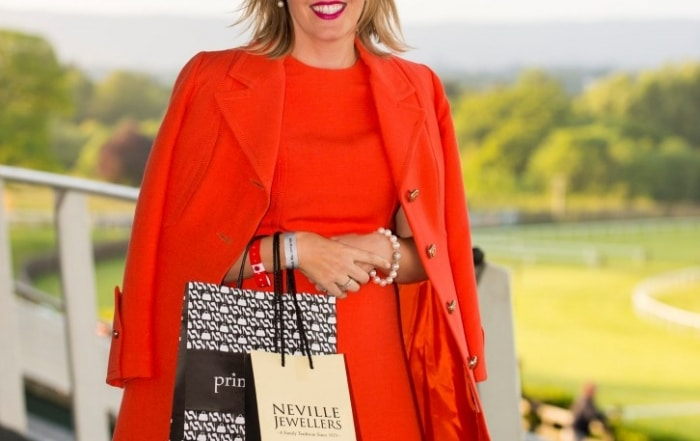 """06/06/2015 Karen Wright from Kinsale was the worthy winner of the Crescent Shopping Centre Twilight Racing Most Stylish competition at Limerick Racecourse on Saturday 6th of June. Karen wowed the judges with a vintage chic orange Jacket and matching dress which was her mother's going away outfit after her wedding in 1973.  The outfit was teamed with a fuchsia and orange hat and clutch to compliment the look.  Karen received vouchers to the value of €300 for Primadonna and Neville Jewellers in the Crescent Shopping centre.  Many ladies pre-registered on www.limerickraces.ie for the competition and the standard of the style was exceptionally high with great summer colours and attention to details.   Fiona Hayes, Fashion Assist, stated """"There was amazing style at the racecourse Saturday evening and most stylish lady Karen Wright stood out because her outfit looked current yet classic""""   This was the first of the twilight evening and a large crowd enjoyed exciting national hunt action followed by the Dublin Gospel Choir.  The next twilight evening takes place on Friday 19th of June with racing from 5.30pm, followed by Prison Love on stage after racing and the final evening is on the 23rd of July with entertainment provided by Mike Denver and his band.  Pictured is Karen Wright, from Kinsale, Co. Cork, winner of Most Stylish Lady sponsored by Crescent Shopping Centre.  Limerick Racecourse, Greenmount Park, Patrickswell, Co. Limerick. Picture: Diarmuid Greene/Fusionshooters"""